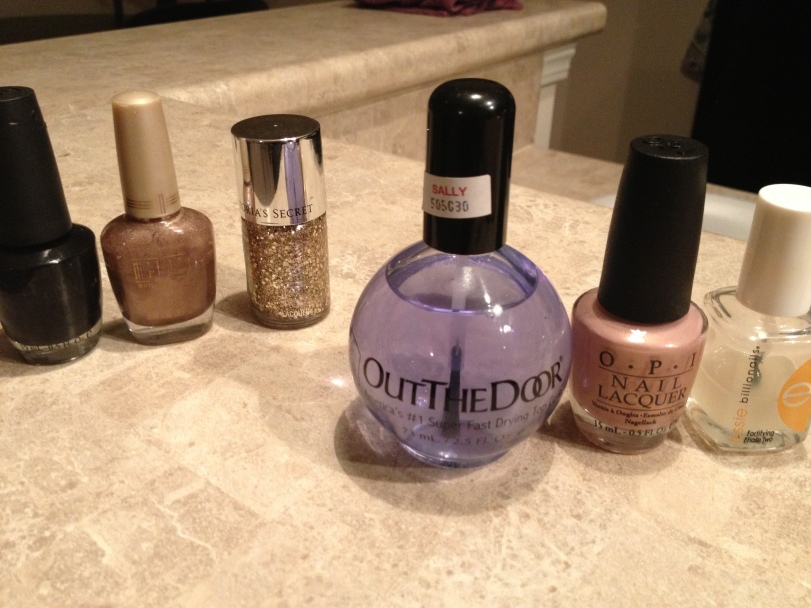 (L to R) : OPI Black Onyx; Malani 36 Mr. Sandman; Victoria Secret Supercharged; Out The Door Super Fast Drying Topcoat; OPI A Butterfly Moment; Essie Billionails Fortifying Basecoat