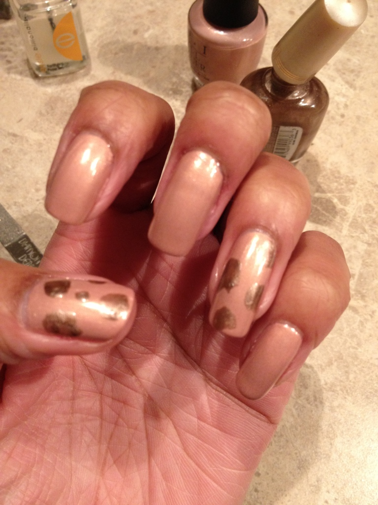 Paint Random Blobs of a Gold or Light Brown Polish. The more random in shape and placement, the better!