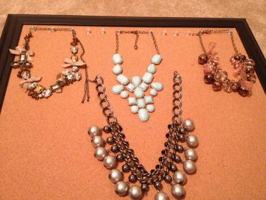 Now for the fun part. Start hanging you're necklaces! The arrangement is up to you.